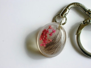 Hair and pink flower keychain