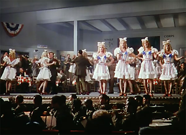 Femulating as Stage Door Canteen hostesses in the 1943 film This is the Army.