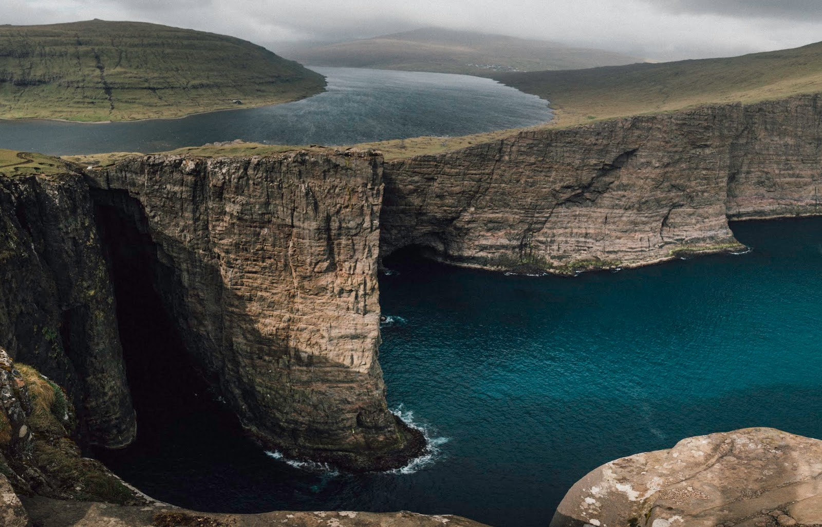 slave cliff lake over the ocean faroe islands liquidgrain liquid grain