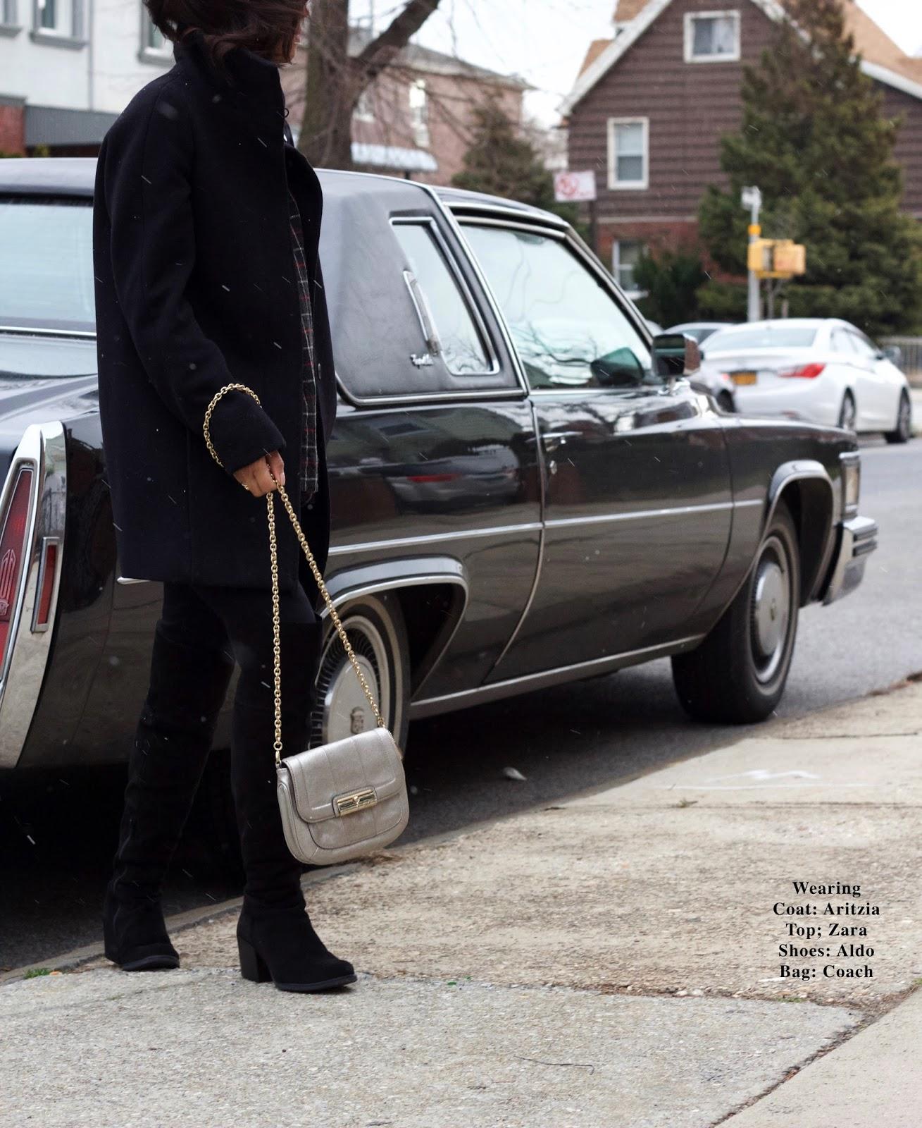 black coat and high black boots