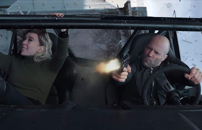 Vanessa Kirby and Jason Statham flip upside down and go airborne in a car in a movie still for the 2019 action film Hobbs and Shaw
