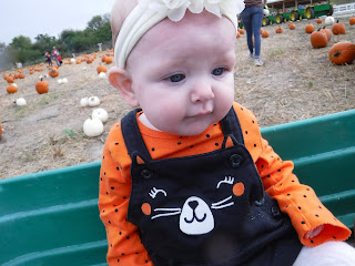 baby at scarecrow farm pumpkin patch