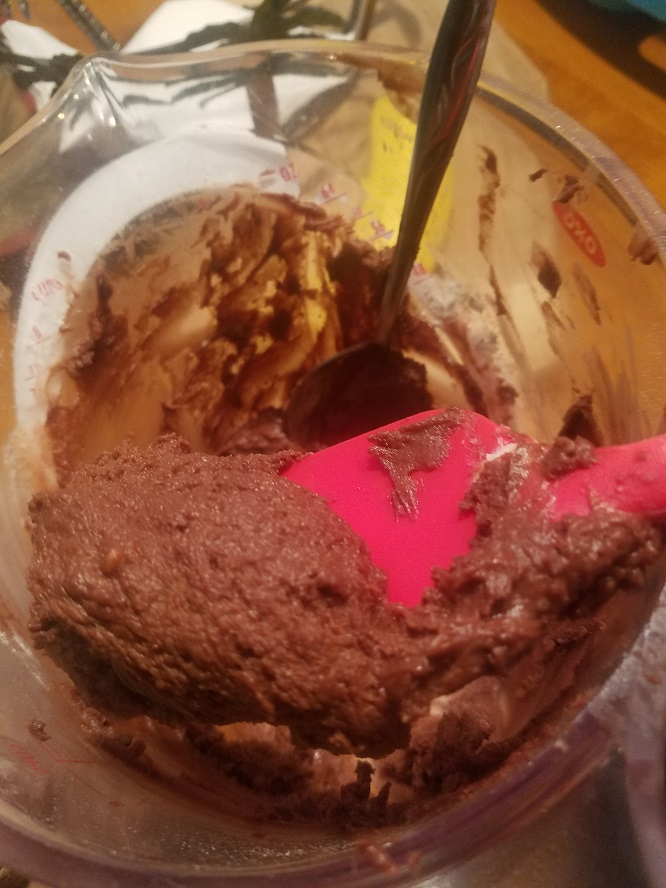thiis is a brownie batter in an OXO bowl