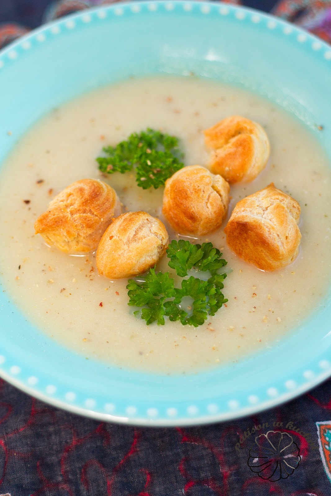 Cream of celery with choux pastry balls.