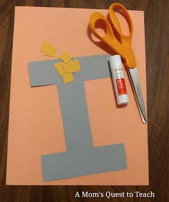 scissors; letter I; construction paper; glue stick