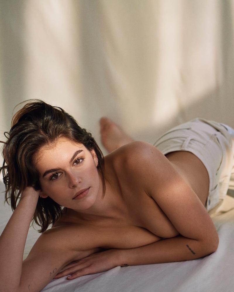 Posing topless, Kaia Gerber models Calvin Klein jeans.