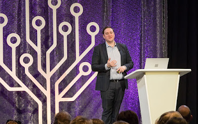 Man addressing audience from RootsTech stage