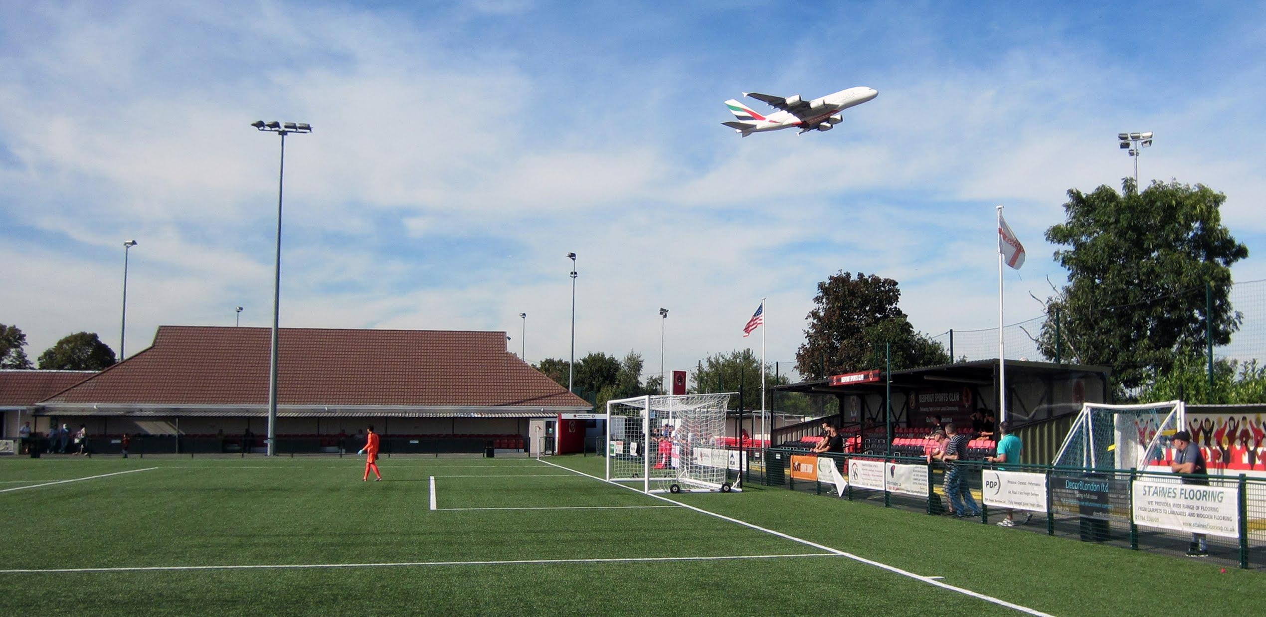 A British Airways flight takes off over Bedfont Sports Recreation Ground