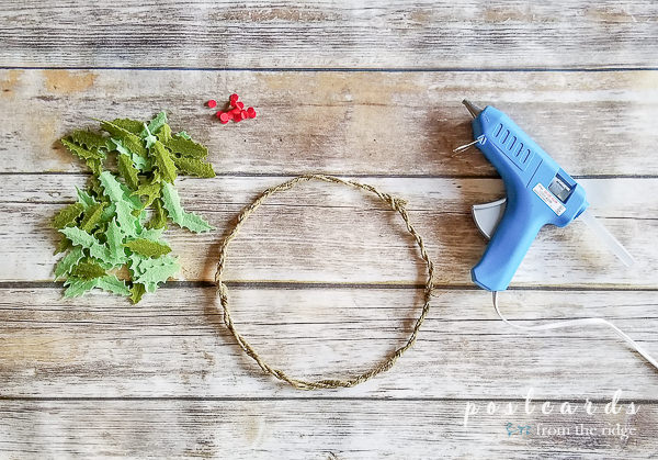 felt holly leaves and wire wreath form with glue gun