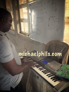 NIgerian learning the piano