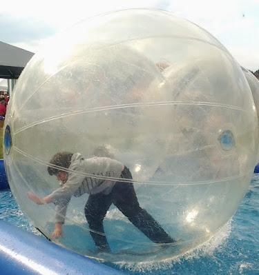 Teenager in Zorb in pool