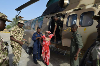Pictures of rescued Chibok girl and her baby undergo medical