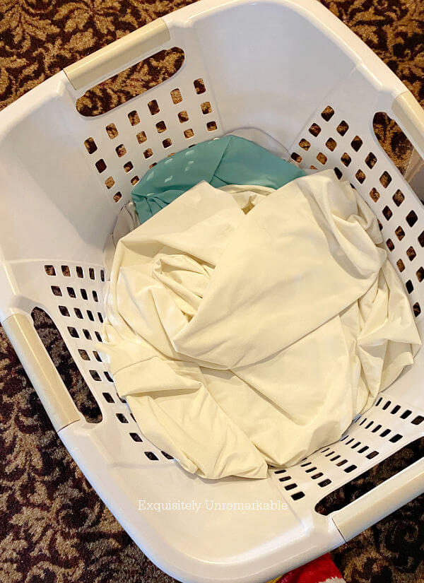 Laundry basket filled with curtains