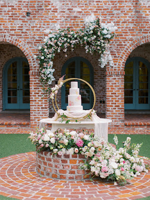 wedding cake display with flowers