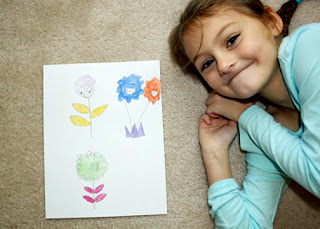 Our flower friend drawings after playing three rounds. Tessa was being fruity and sneaked into my pic.
