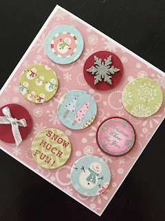 Hand made Christmas card with paper circles and various embellishments