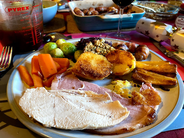 A plate with our Christmas dinner: ham, chicken, roast pototoes, roast parsnips, pigs in blankets, stuffing, braised cabbage, sprouts and carrots