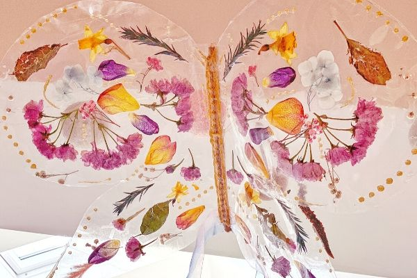 butterfly fairy wings made from contact paper and pressed flowers