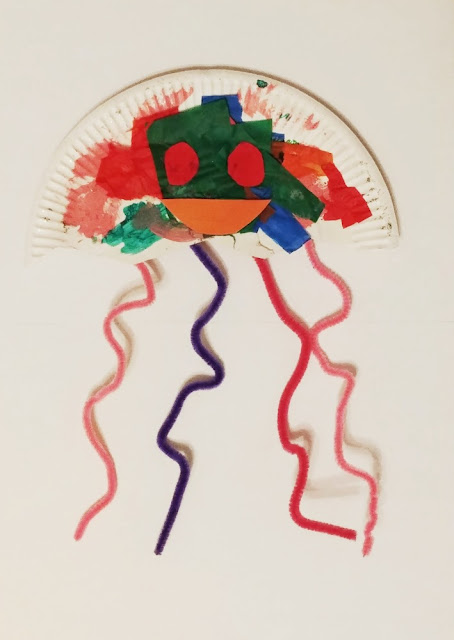 photo of diy art of a jellyfish by a toddler