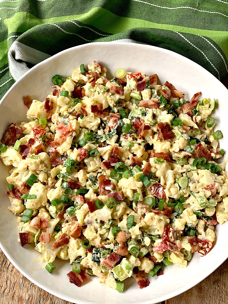 BLT CAULIFLOWER SALAD - This BLT Cauliflower Salad recipe is the perfect low carb and keto-friendly replacement for traditional potato salad. It is the perfect side dish for SO many low carb mains and a favorite of my keto and non-keto friends and family! #sidedish #cauliflower #potatosalad #keto #lowcarb #bacon #BLT #salad #easy #recipe | bobbiskozykitchen.com