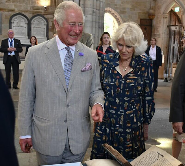 Charles wearing a crisp grey suit and Camilla wore her favourite dress by Fiona Clare