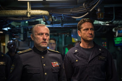 Movie still of Michael Nyqvist and Gerard Butler standing in a submarine in the film Hunter Killer
