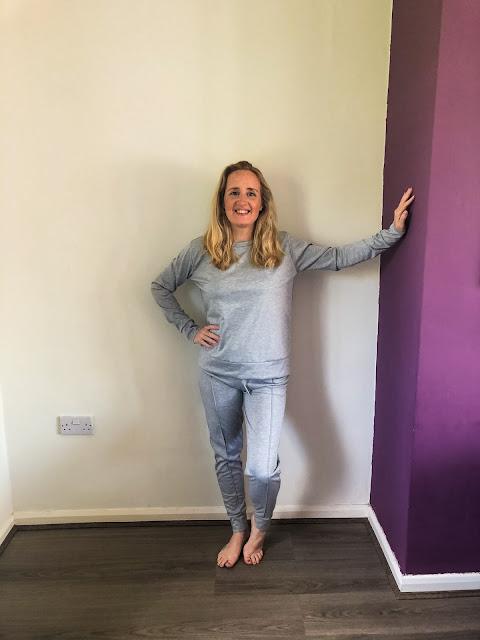 how to wear loungewear past lockdown - Femme Luxe loungewear - standing in grey loungewear jogging bottoms and matching sweater