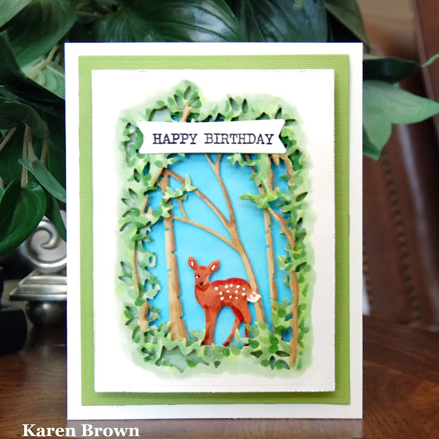 A Handmade Woodland Diorama card with forest and deer.