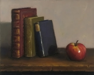 Still life oil painting of an apple beside three old books standing vertically.