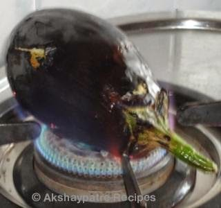 burn the brinjal on stove top