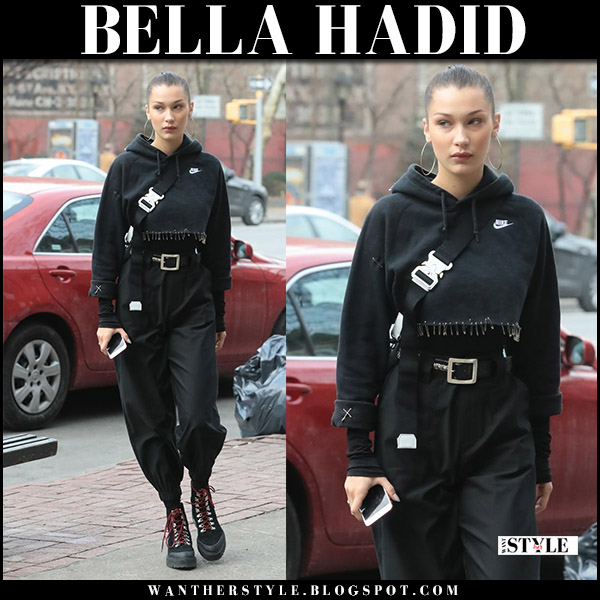 Bella Hadid in black cropped hoodie and black cargo pants i.am.gia cobain model street style december 17