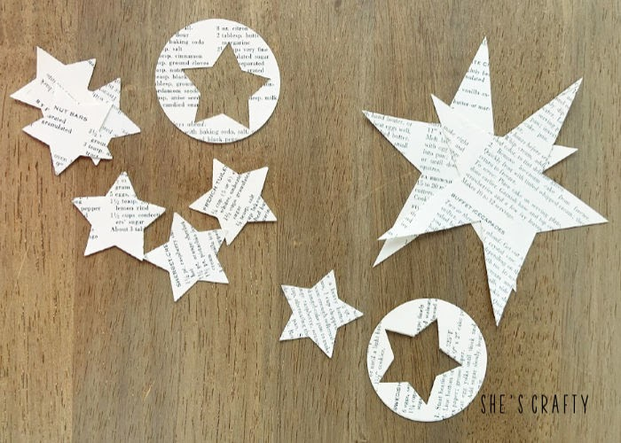 Use star and circle punches to punch stars from book page paper to make table centerpiece
