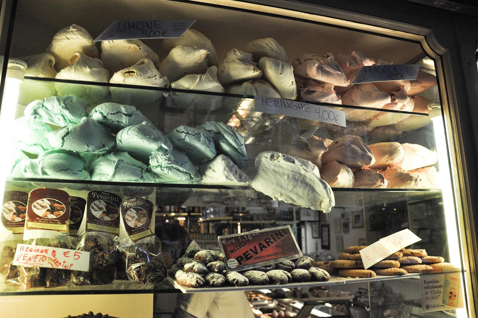 Giant meringues in the window display of a patisserie in Padua, Italy