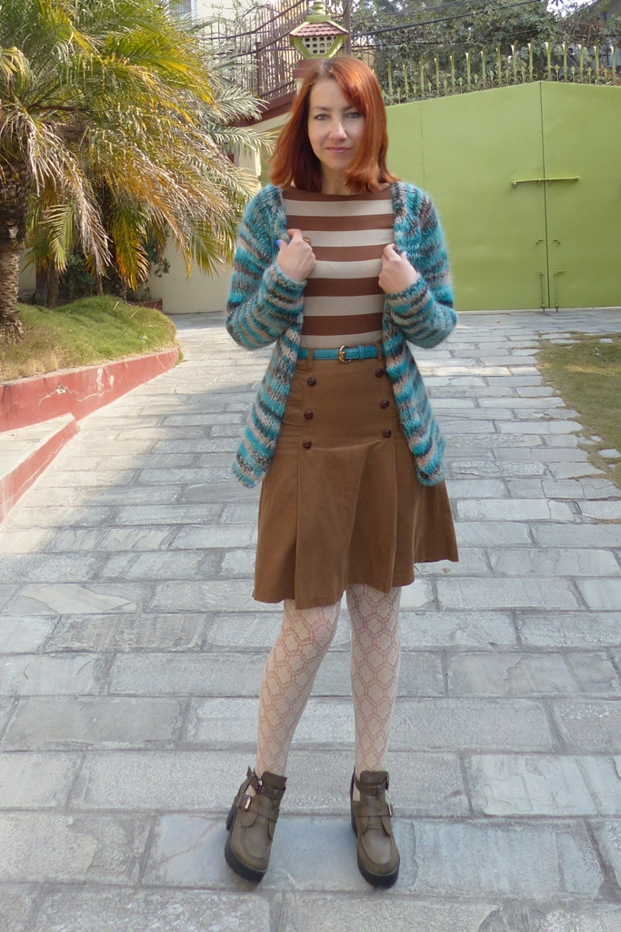 Hand knit cardigan in turquoise and brown with corduroy skirt