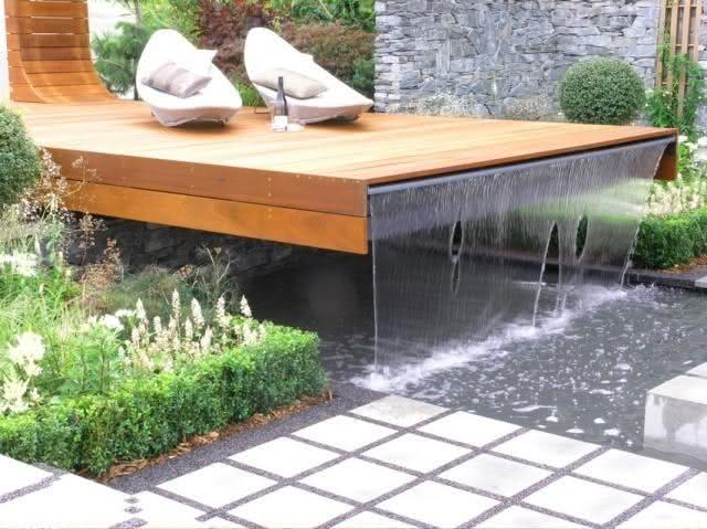 Waterfall for pool leaving the wooden deck
