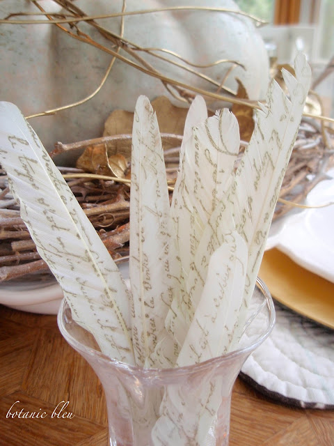 Thanksgiving gold and white table setting with DIY french script stamped white feathers