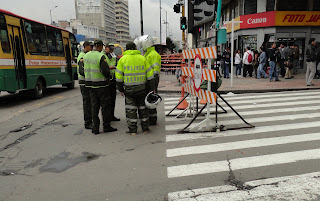 Efficient use of resources - a group of Bogotá's Transport Police manning a junction that already has a barrier erected. It gets them out of the office anyway