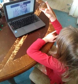 A child looks at a laptop