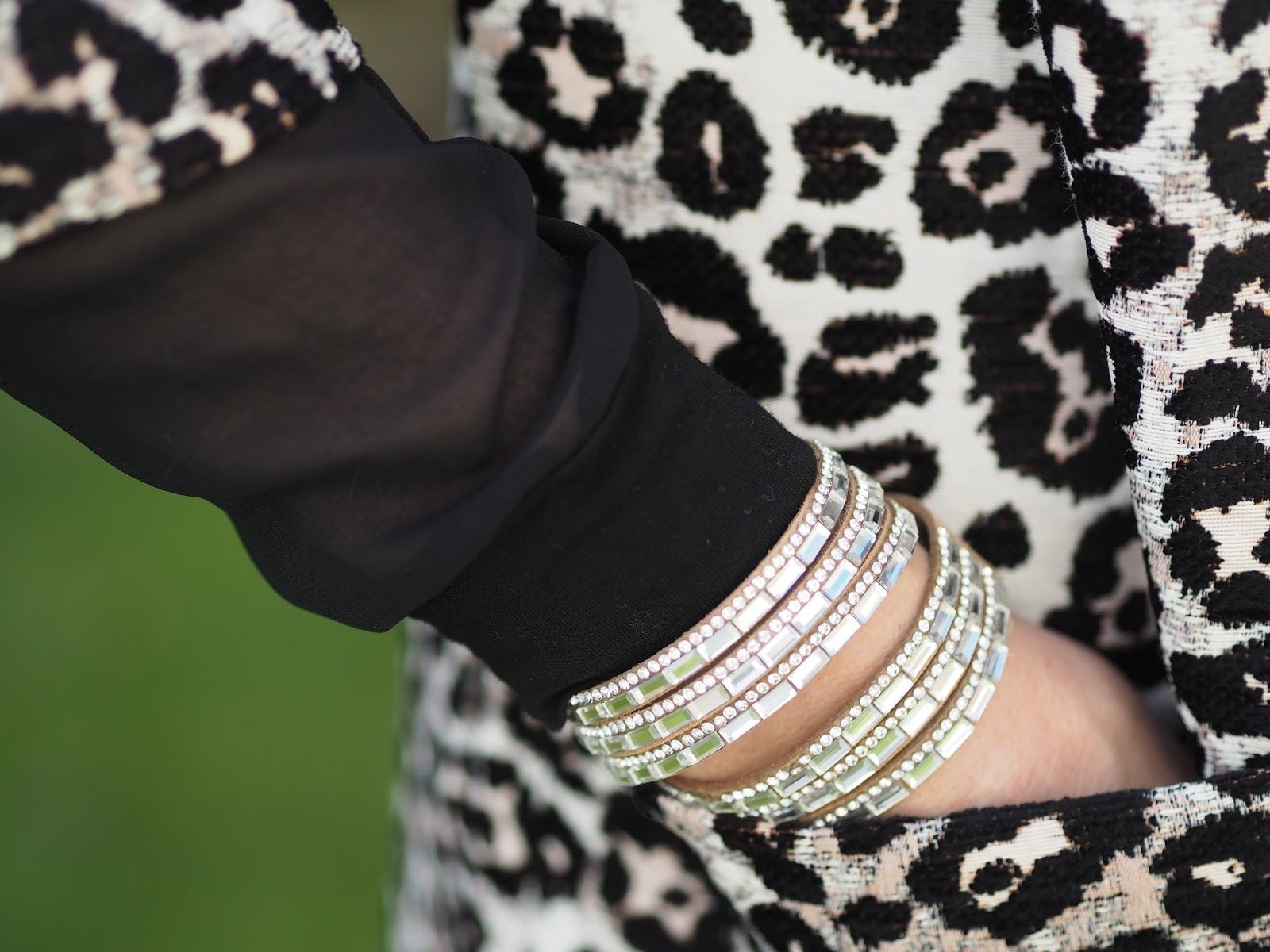 Animal leopard print jacquard jacket and skinny jeans and diamante wrap bracelet and