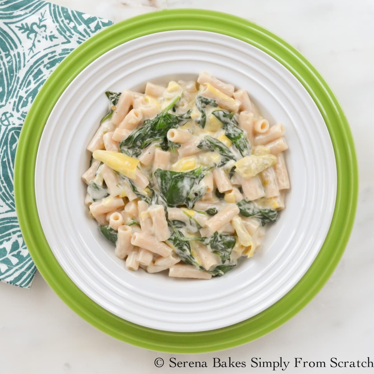 A down shot of Spinach Artichoke Pasta in a bowl.