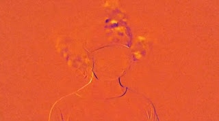 image from an Infrared video of a woman wearing an unfitted surgical mask