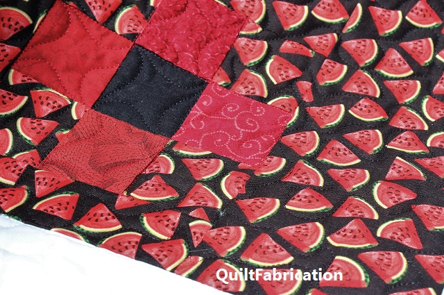 stipple quilting around in the watermelon print