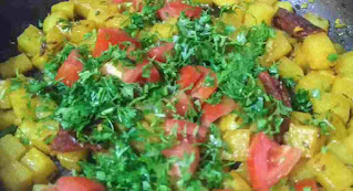 Shalgam cubes with tomato and coriander leaves