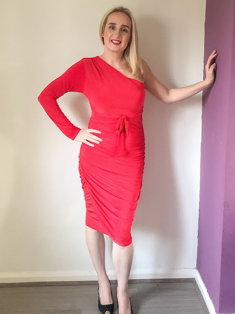 Standing in a one shoulder red dress / winter dresses from Femme Luxe