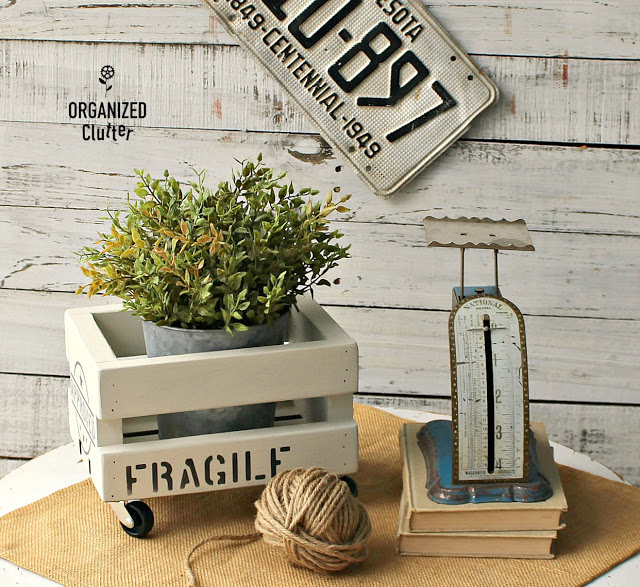 A mini crate stenciled with shipping stamps