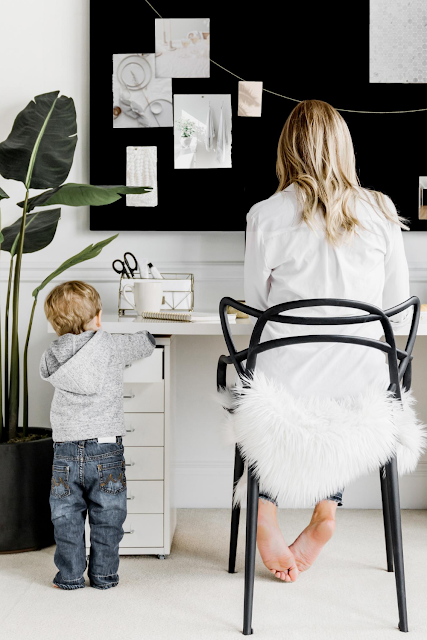 Mom with Toddler Working at Desk at Home