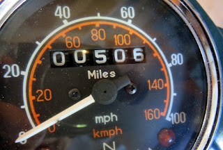 Close-up of Royal Enfield odometer showing 506 miles.