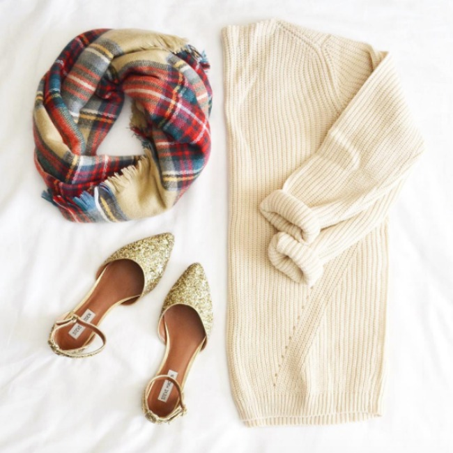 Cute outfit idea flat lay with a ribbed sweater, plaid blanket scarf, and gold glitter steve madden flats