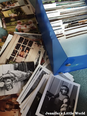 Box of old photographs for Marie Kondo sorting