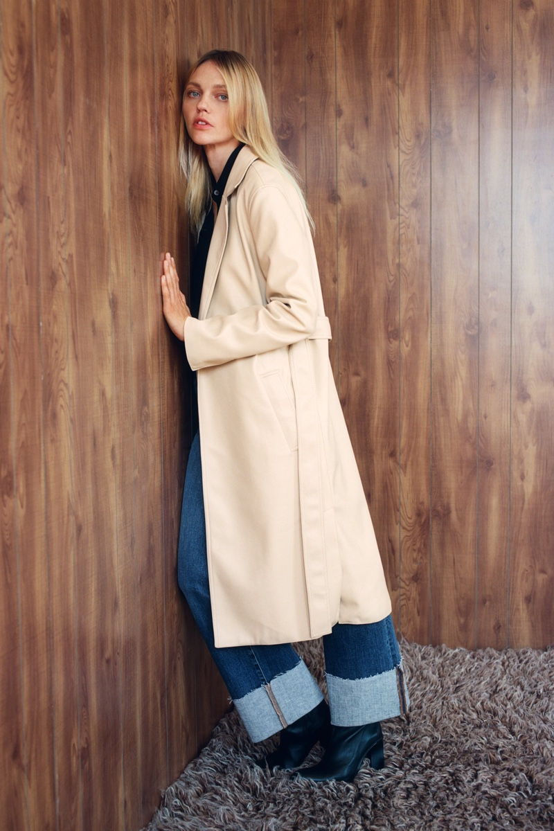 Model Sasha Pivovarova layers up in Zara faux leather trench coat.
